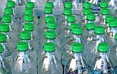stock photo of bottles  - Bottled Water being stored for Disaster Preparedness - JPG