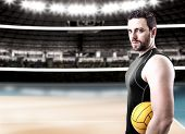 foto of volleyball  - Volleyball player on black uniform on volleyball court - JPG