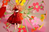 picture of rag-doll  - Cute doll with red dress in natural light - JPG
