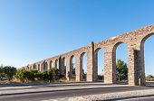 pic of aqueduct  - Ancient Roman aqueduct in Evora in afternoon sun Portugal - JPG