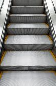 picture of escalator  - Shining metal escalator moving up vertical photo with perspective effect - JPG