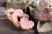 picture of glass heart  - Heart shaped cookies for valentines day in glass jar on  wooden background - JPG
