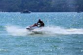 foto of waverunner  - man drive on the jetski at Patong beach Phuket Thailand - JPG