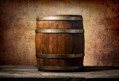 pic of keg  - Wooden barrel on a table and textured background - JPG