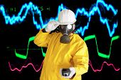 stock photo of electrical engineering  - man in hard hat and gas mask  - JPG
