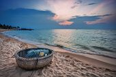 stock photo of old boat  - Traditional round Vietnamese boat   - JPG