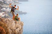 stock photo of edging  - Young couple on rock and enjoying beautiful view - JPG