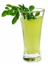 picture of malunggay  - Ayurvedic Juice made from moringa leaves over white background - JPG