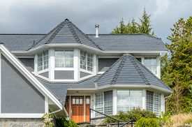 picture of red roof  - The roof of the house with nice window - JPG