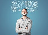 picture of taboo  - Young man with taped mouth and white drawn thought clouds around his head  - JPG