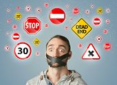 image of taboo  - Young man with taped mouth and traffic signals around his head   - JPG