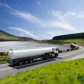 stock photo of petrol  - A fuel tanker truck hauling a load of gasoline - JPG