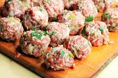 pic of meatball  - Raw meatballs on the wooden chopping board - JPG