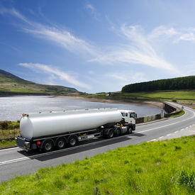 stock photo of tank truck  - A fuel tanker truck hauling a load of gasoline - JPG