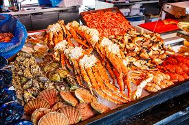 stock photo of norway lobster  - Various seafood on the shelves of the fish market in Norway - JPG