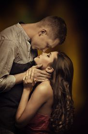 stock photo of intimate  - Young Couple Kissing in Love Woman Man Romantic Passion Desire Intimate Emotions of Lovers - JPG