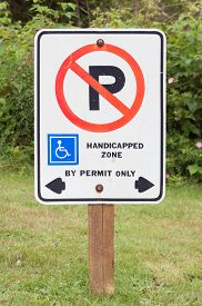 stock photo of grass area  - No parking in handicapped zone sign - JPG