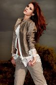 beautiful brunette woman in leather jacket and white shirt outdoor portrait