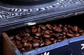 stock photo of wooden box from coffee mill  - old coffee mill with Beans inside the wooden box - JPG