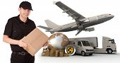 A messenger holding a package with a world map, packages, a chronometer,  a van, a truck and an airp