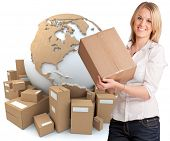 A woman holding a box with the world surrounded by packages in the background