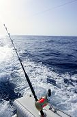 Big game boat saltwater fishing tourney with two rod and reel