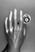 Health stethoscope futuristic silver gray hand concept metaphor