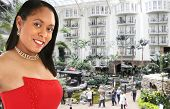 stock photo of opryland  - Beautiful 20 something african american woman in red formal dress at the atrium in hotel in - JPG