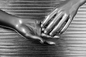 hands together futuristic robot silver steel over gray background