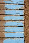 aged beach blue wooden floor over summer sand