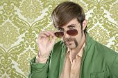 foto of dork  - geek retro salesperson man funny mustache sunglasses in green wallpaper - JPG