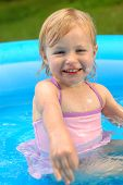 Little Blonde Girl In Wading Pool