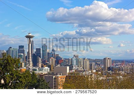 poster of Urban Seattle Panorama And Distinctive Peak Of Mount Rainier Above The Clouds On Horizon. Scenic Vie