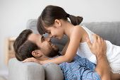 Cute Little Girl Tenderly Touching Noses With Happy Dad poster