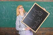 Hiring Teachers For New School Year. Woman Teacher Holds Blackboard Inscription Back To School. Look poster