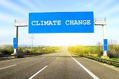 Blue Freeway Sign Over The Road On Sunny Day With Words Climate Change On It poster