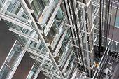 Looking Down In  An Open Steel Lift Shaft In A Modern Buildin