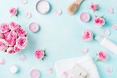 Aromatherapy, Spa, Beauty Background With Roses Flowers, Cosmetics And Candles On Blue Table. Flat L poster