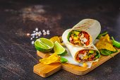 Grilled Burritos Wraps With Chicken, Beans, Corn, Tomatoes And Avocado On A Wooden Board, Dark Backg poster
