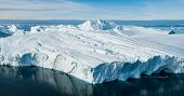 Global Warming and Climate Change - Giant Iceberg from melting glacier in Ilulissat, Greenland. Aeri poster