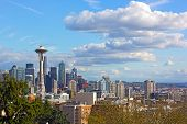 Urban Seattle Panorama And Distinctive Peak Of Mount Rainier Above The Clouds On Horizon. Scenic Vie poster