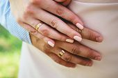 Wedding Rings. Newly Wed Couples Hands With Wedding Rings. Bride And Grooms Hands With Wedding Rings poster