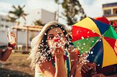 Brazilian Carnival. Young Woman In Costume Enjoying The Carnival Party Blowing Confetti poster
