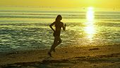 Girl Running By The Sea On The Beach poster