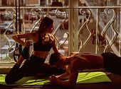Man And Woman In Sportswear In Gym, Window On Background. Couple Stretching Or Busy With Physical Pr poster