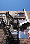 Black Fire Escape And Metal Ductwork
