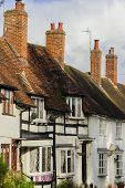 picture of english cottage garden  - a cottage in an english village - JPG