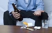 image of alcohol abuse  - Businessman doing mixed use of drugs and alcohol - JPG