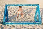 Girl Plays Beach Soccer