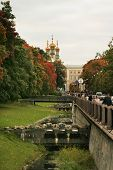 Canal In The Autumn Park And The Cathedral In Perspective